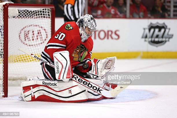 Corey Crawford of the Chicago Blackhawks makes a save against the Los Angeles Kings in the first period during Game Five of the Western Conference...