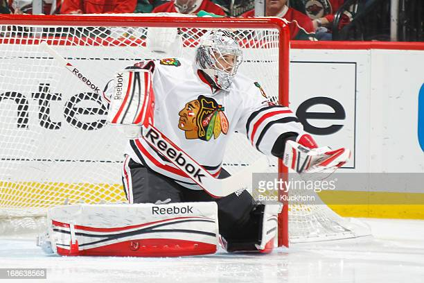 Corey Crawford of the Chicago Blackhawks makes a save against the Minnesota Wild in Game Four of the Western Conference Quarterfinals during the 2013...