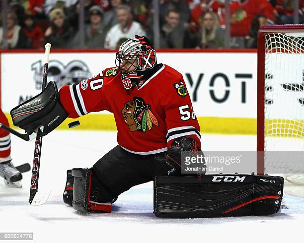 Corey Crawford of the Chicago Blackhawks makes a save against the Tampa Bay Lightning at the United Center on January 24 2017 in Chicago Illinois
