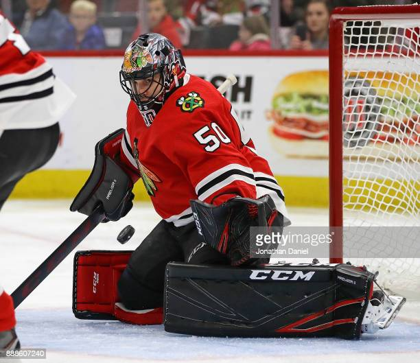 Corey Crawford of the Chicago Blackhawks makes a save against the Buffalo Sabres at the United Center on December 8 2017 in Chicago Illinois