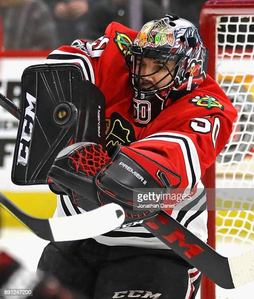 Corey Crawford of the Chicago Blackhawks makes a save against the Florida Panthers at the United Center on December 12 2017 in Chicago Illinois