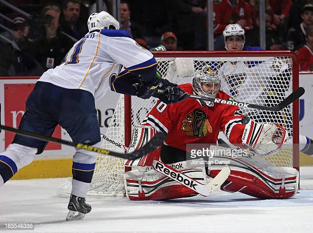 Corey Crawford of the Chicago Blackhawks makes a save on a shot by Valdimir Tarasenko of the St Louis Blues at the United Center on April 4 2013 in...