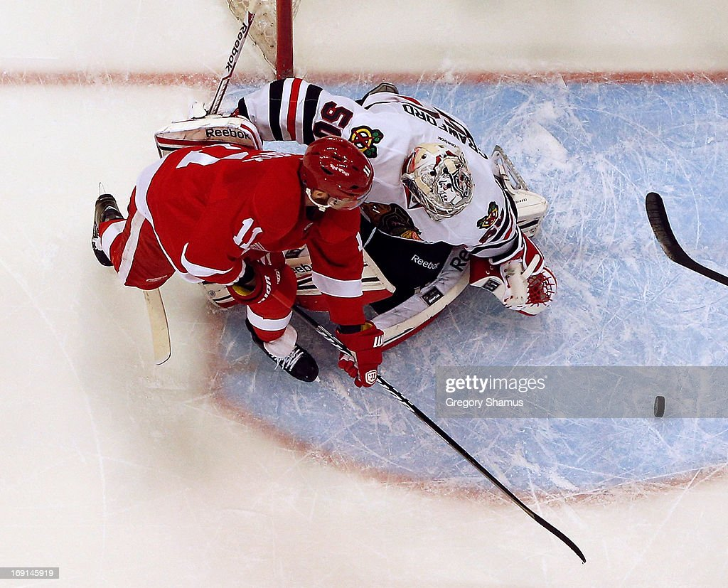 Corey Crawford #50 of the Chicago Blackhawks makes a save on a shot by Daniel Cleary #11 of the Detroit Red Wings in Game Three of the Western Conference Semifinals during the 2013 NHL Stanley Cup Playoffs at Joe Louis Arena on May 20, 2013 in Detroit, Michigan. Detroit won the game 3-1 to take a 2-1 series lead.