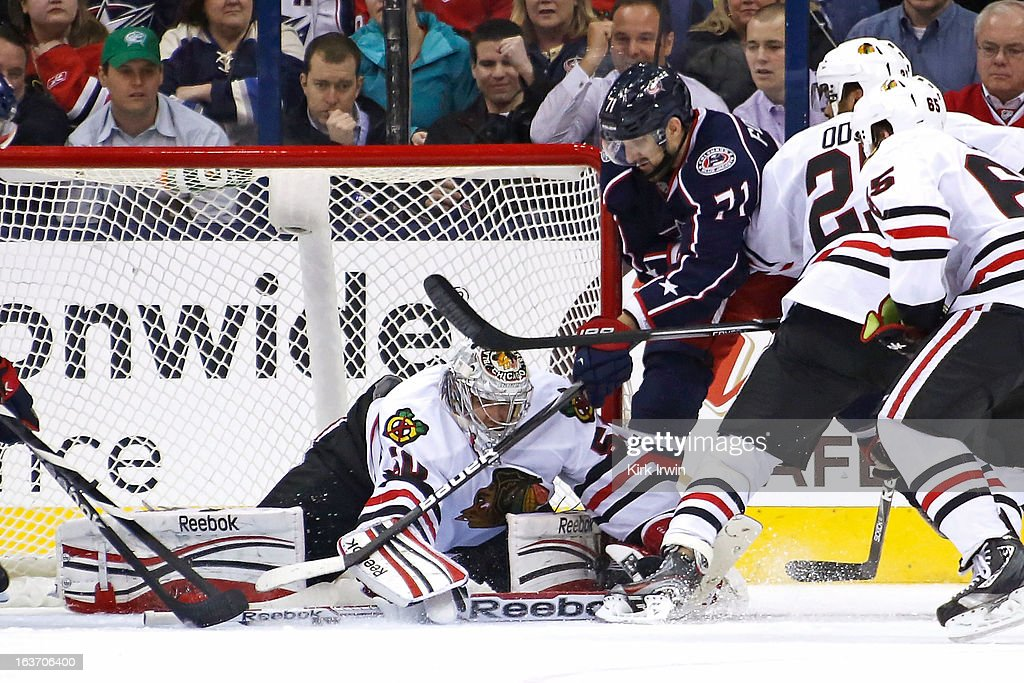 Corey Crawford #50 of the Chicago Blackhawks makes a save on a shot from Nick Foligno #71 of the Columbus Blue Jackets during the third period on March 14, 2013 at Nationwide Arena in Columbus, Ohio. Chicago defeated Columbus 2-1 in a shootout.