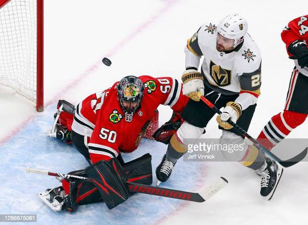 Corey Crawford of the Chicago Blackhawks makes the first period save as William Carrier of the Vegas Golden Knights looks for the rebound in Game...