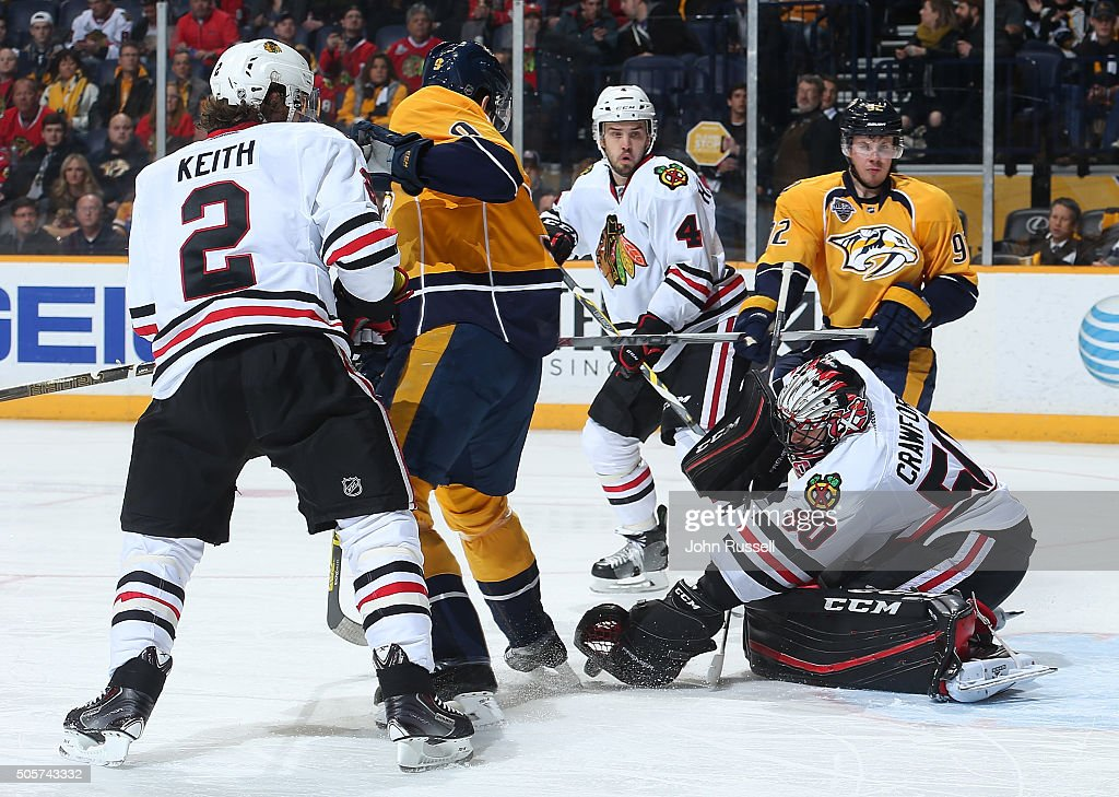 Corey Crawford #50 of the Chicago Blackhawks makes the save against Filip Forsberg #9 of the Nashville Predators during an NHL game at Bridgestone Arena on January 19, 2016 in Nashville, Tennessee.
