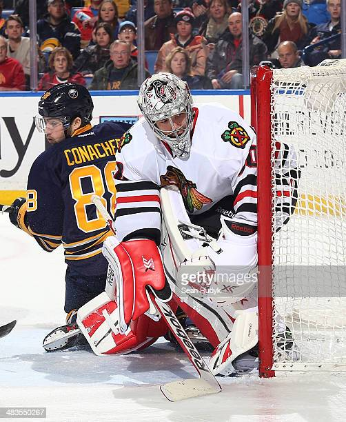 Corey Crawford of the Chicago Blackhawks protects the net against Cory Conacher of the Buffalo Sabres at First Niagara Center on March 9 2014 in...