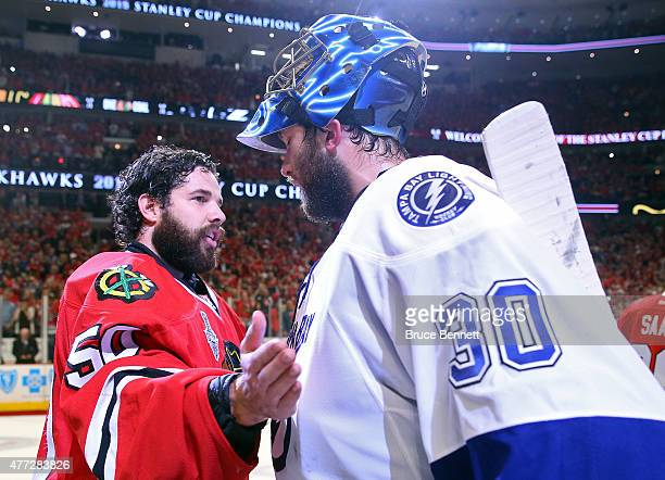 Corey Crawford of the Chicago Blackhawks shakes hands with Ben Bishop of the Tampa Bay Lightning after the Blackhawks won Game Six by a score of 20...