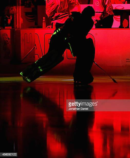 Corey Crawford of the Chicago Blackhawks skates onto the ice dirng player introductions before a preseason game against the Detroit Red Wings at the...
