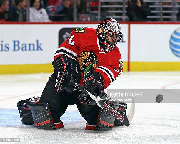 Corey Crawford of the Chicago Blackhawks slaps the puck away against the St Louis Blues in Game Four of the Western Conference First Round during the...