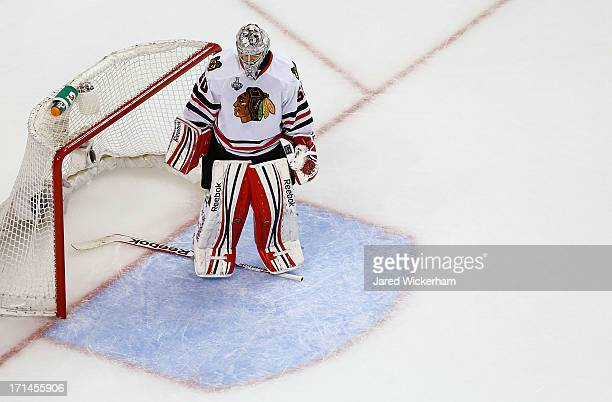 Corey Crawford of the Chicago Blackhawks stands in goal after losing his stick in the first period against the Boston Bruins during Game Six of the...