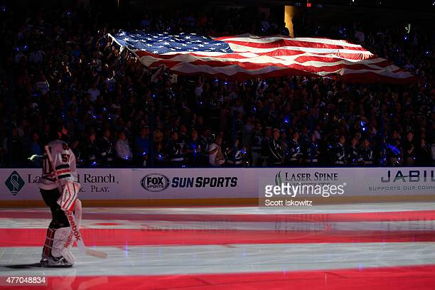 Corey Crawford of the Chicago Blackhawks stands on the ice as an American Flag is passed around prior to Game Five of the 2015 NHL Stanley Cup Final...