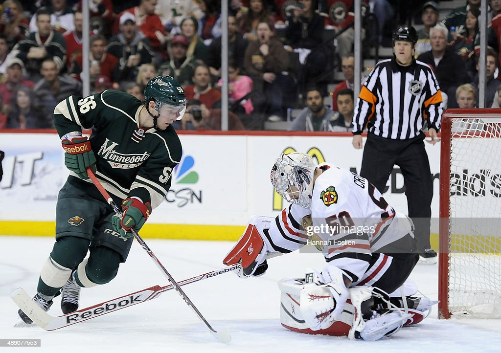 Corey Crawford #50 of the Chicago Blackhawks stops a shot by Erik Haula #56 of the Minnesota Wild during the second period in Game Four of the Second Round of the 2014 NHL Stanley Cup Playoffs on May 9, 2014 at Xcel Energy Center in St Paul, Minnesota. The Wild defeated the Blackhawks 4-2.