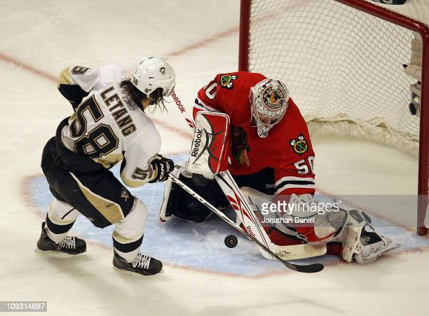 Corey Crawford of the Chicago Blackhawks stops a shot in the shootout by Kris Letang of the Pittsburgh Penguins at the United Center on February 20...
