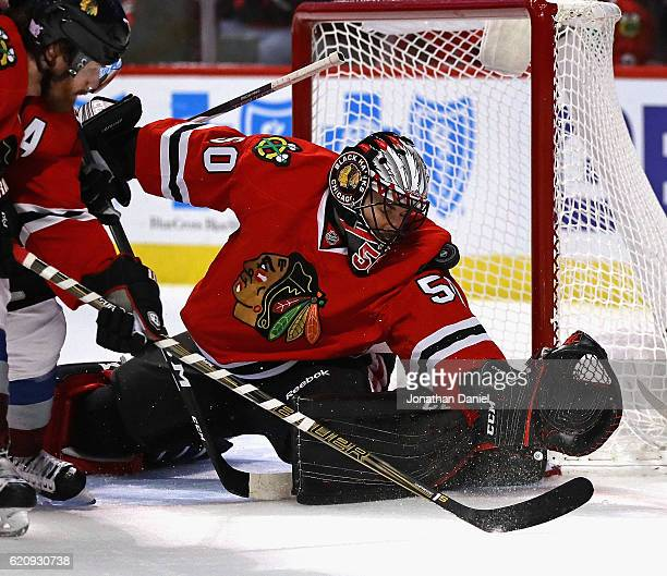 Corey Crawford of the Chicago Blackhawks stops a shot with his shoulder against the Colorado Avalanche at the United Center on November 3 2016 in...