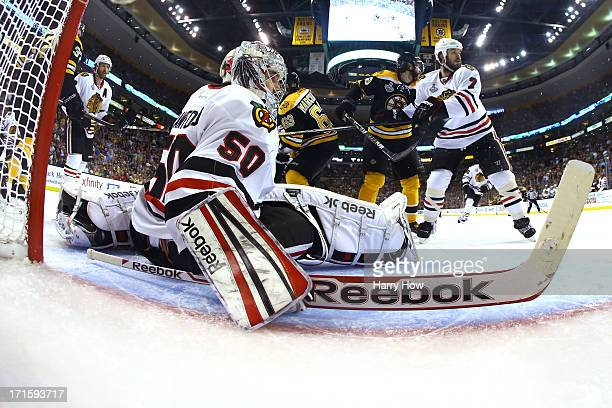 Corey Crawford of the Chicago Blackhawks tends goal against the Boston Bruins in Game Six of the 2013 NHL Stanley Cup Final at TD Garden on June 24...