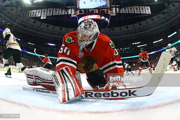 Corey Crawford of the Chicago Blackhawks tends goal in the first period against the Boston Bruins in Game Five of the 2013 NHL Stanley Cup Final at...
