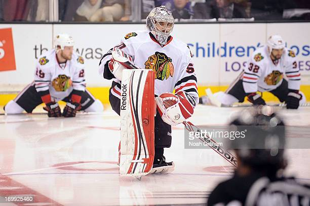 Corey Crawford of the Chicago Blackhawks warms up prior to the game against the Los Angeles Kings in Game Three of the Western Conference Final...