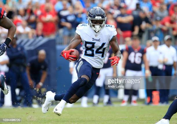 Corey Davis 384 of the Tennessee Titans runs the ball against the Houston Texans during the fourth quarter at Nissan Stadium on September 16, 2018 in...