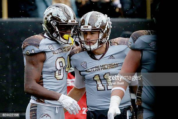 Corey Davis and Zach Terrell of the Western Michigan Broncos celebrate after scoring a touchdown in the second quarter against the Buffalo Bulls at...