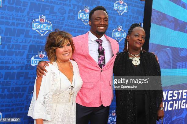 Corey Davis from Western Michigan with his mother Michelle and Robin Graham on the Red Carpet outside of the NFL Draft Theater on April 27 2017 in...