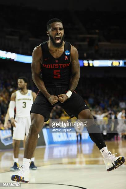 Corey Davis Jr. #5 of the Houston Cougars celebrates a foul called against Michigan Wolverines in the second half during the second round of the 2018...