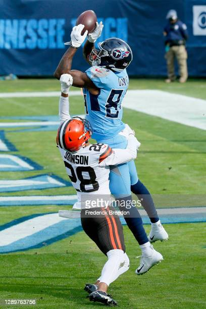 Corey Davis of the Tennessee Titans catches a pass for a touchdown against Kevin Johnson of the Cleveland Browns in the second quarter at Nissan...