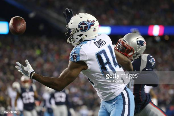 Corey Davis of the Tennessee Titans catches a touchdown pass as he is defended by Malcolm Butler of the New England Patriots in the first quarter of...