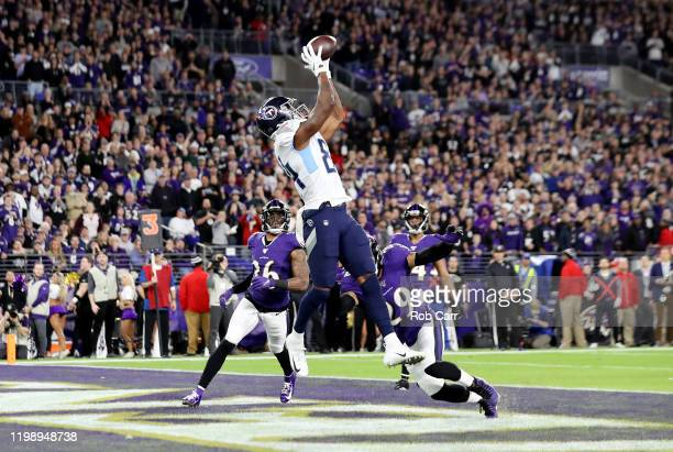 Corey Davis of the Tennessee Titans catches a touchdown pass during the third quarter against the Baltimore Ravens in the AFC Divisional Playoff game...