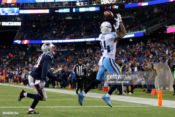 Corey Davis of the Tennessee Titans catches a touchdown pass during the fourth quarter against the New England Patriots in the AFC Divisional Playoff...