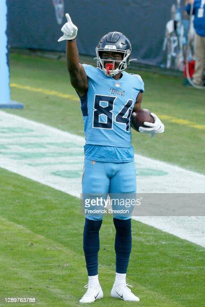 Corey Davis of the Tennessee Titans celebrates a touchdown against the Cleveland Browns in the second quarter at Nissan Stadium on December 06, 2020...