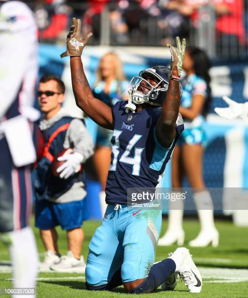 Corey Davis of the Tennessee Titans celebrates a touchdown during the first quarter against the New England Patriots at Nissan Stadium on November 11...