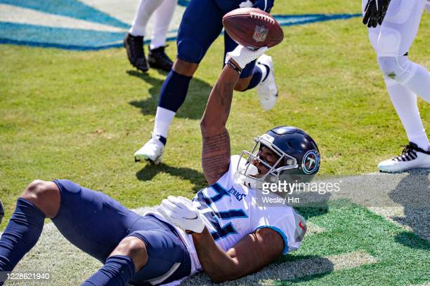Corey Davis of the Tennessee Titans celebrates after catching a pass for a touchdown in the first half during a game against the Jacksonville Jaguars...