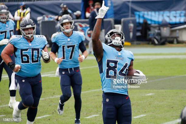Corey Davis of the Tennessee Titans celebrates after scoring a touchdown against the Pittsburgh Steelers during the first half at Nissan Stadium on...
