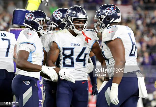 Corey Davis of the Tennessee Titans celebrates with teammates after catching a touchdown pass during the third quarter against the Baltimore Ravens...