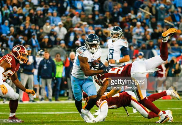 Corey Davis of the Tennessee Titans is defended by Ha Ha Clinton-Dix of the Washington Redskins and Mason Foster while running with the ball during...