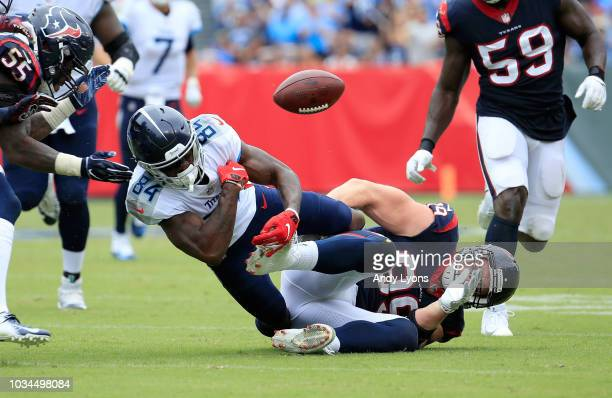 Corey Davis of the Tennessee Titans loses the ball while being tackled by J.J. Watt of the Houston Texans at Nissan Stadium on September 16, 2018 in...