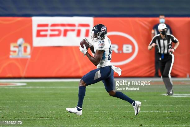 Corey Davis of the Tennessee Titans makes a catch against the Denver Broncos in the third quarter of a game at Empower Field at Mile High on...