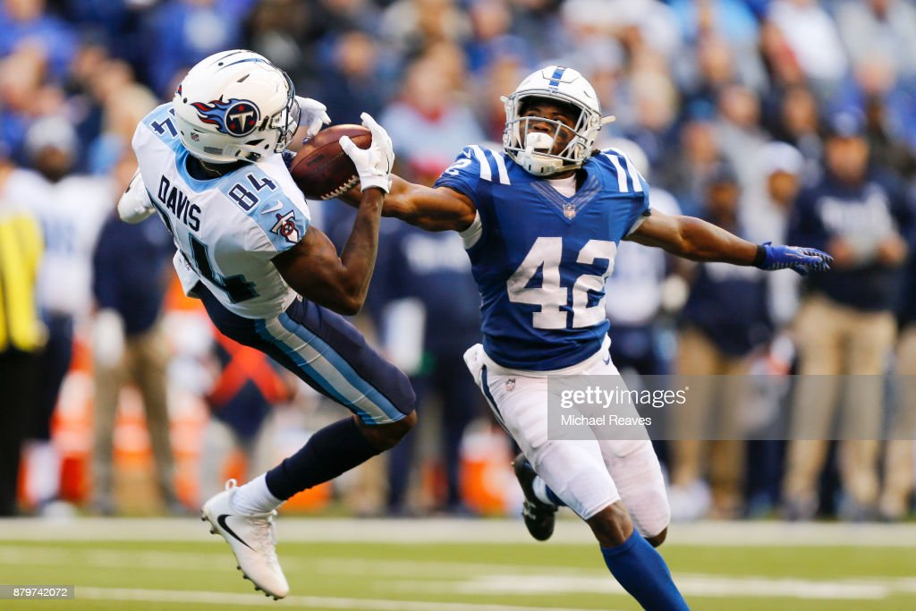 Corey Davis #84 of the Tennessee Titans makes a catch defended by Kenny Moore II#42 of the Indianapolis Colts at Lucas Oil Stadium on November 26, 2017 in Indianapolis, Indiana.