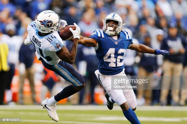 Corey Davis of the Tennessee Titans makes a catch defended by Kenny Moore II#42 of the Indianapolis Colts at Lucas Oil Stadium on November 26 2017 in...