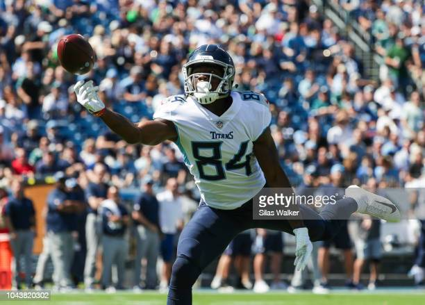 Corey Davis of the Tennessee Titans reaches for a pass from Marcus Mariota against the Philadelphia Eagles during the first quarter at Nissan Stadium...