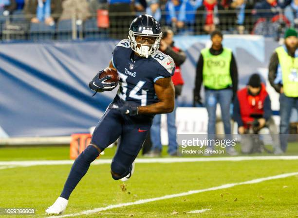 Corey Davis of the Tennessee Titans runs downfield with the ball against the Jacksonville Jaguars during the first quarter at Nissan Stadium on...