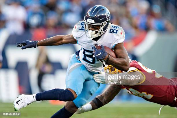 Corey Davis of the Tennessee Titans runs the ball during a game against the Washington Redskins at Nissan Stadium on December 22, 2018 in Nashville,...