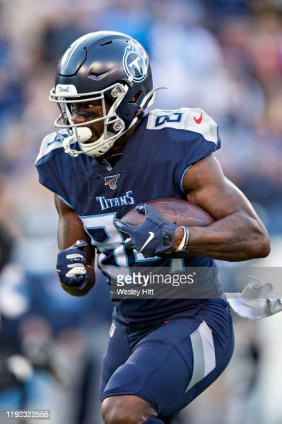Corey Davis of the Tennessee Titans runs the ball during the first half of a game against the Jacksonville Jaguars at Nissan Stadium on November 24,...
