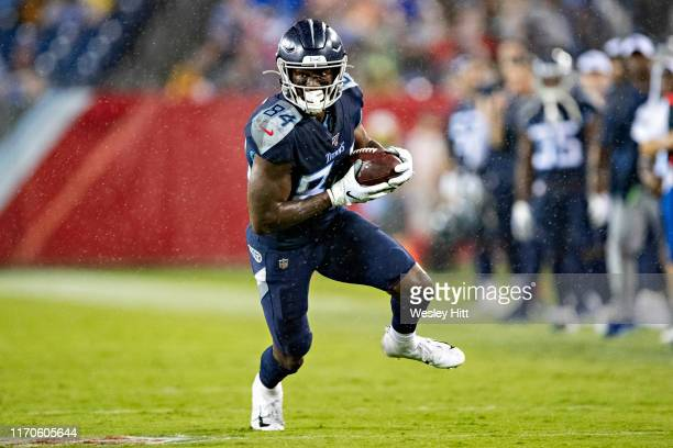 Corey Davis of the Tennessee Titans runs with the ball after catching a pass during a game against the Pittsburgh Steelers during week three of...