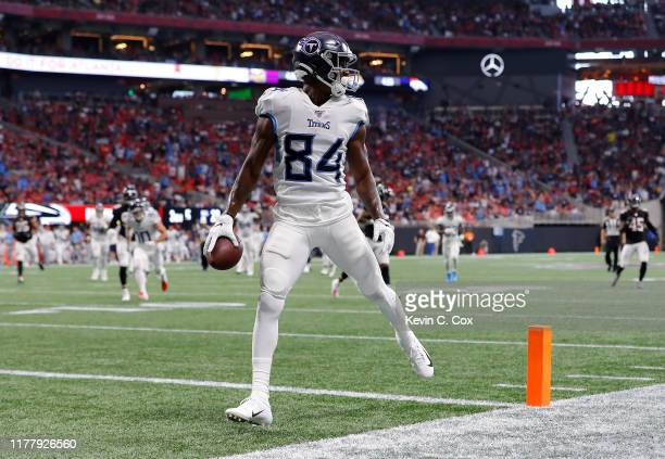 Corey Davis of the Tennessee Titans scores this touchdown against the Atlanta Braves at Mercedes-Benz Stadium on September 29, 2019 in Atlanta,...