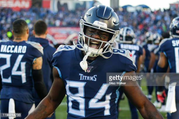 Corey Davis of the Tennessee Titans shouts as he runs onto the field before the game against the Jacksonville Jaguars at Nissan Stadium on November...
