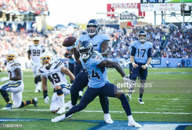 Corey Davis of the Tennessee Titans spikes the ball after scoring a touchdown against the Los Angeles Chargers to tie the game during the second...
