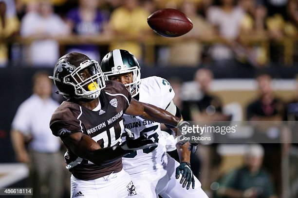 Corey Davis of the Western Michigan Broncos makes a 17-yard touchdown reception in the second half against the Michigan State Spartans at Waldo...