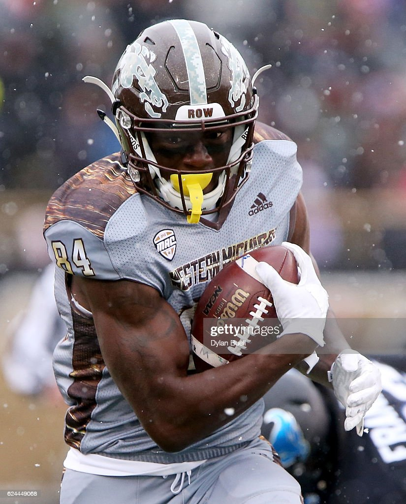 Corey Davis #84 of the Western Michigan Broncos runs with the ball in the first quarter against the Buffalo Bulls at Waldo Stadium on November 19, 2016 in Kalamazoo, Michigan.